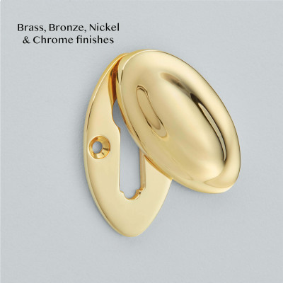 Raised Oval Covered Escutcheon in Polished Brass unlacquered