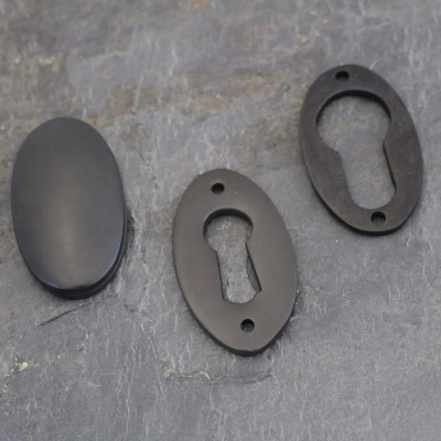 Aged Bronze Period Oval Escutcheons