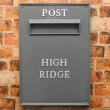 Grey post box fronts